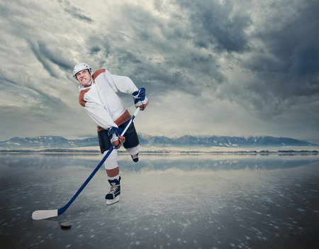 ice surface: Hockey player on the ice lake surface Stock Photo