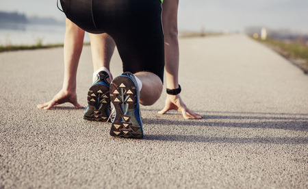 close up image: Close up image sprinter legs on the start Stock Photo