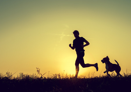 persons: Evening jogging with beagle pet