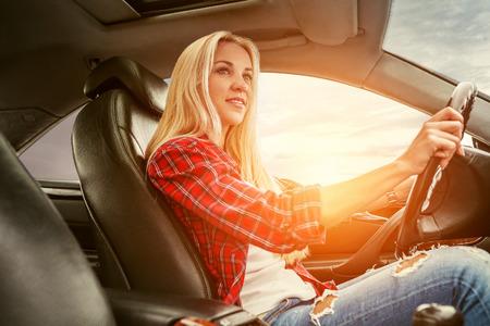 Young blonde drive a car Standard-Bild