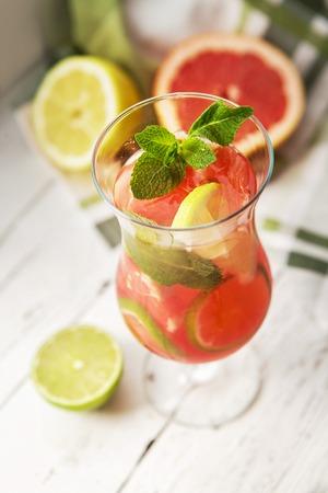 Homemade lemonade in tall glass photo