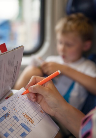 waster: Son with mother playing a sea battle game during train trip