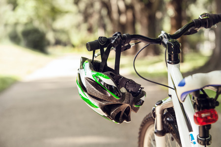reflector: Safety helmet on the bicycle handlebar