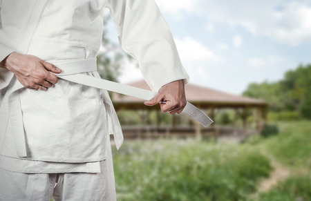 karate fighter: Karate master prepares for combat in high mountain village Stock Photo