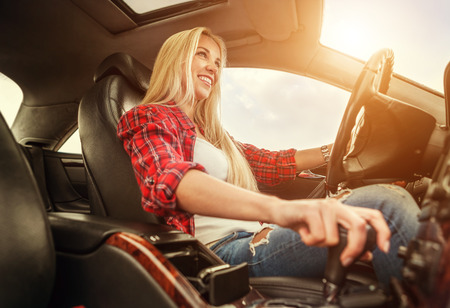 female driver: Young woman drive a car Stock Photo