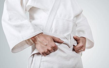 tang: Tying kimono belt close up image Stock Photo