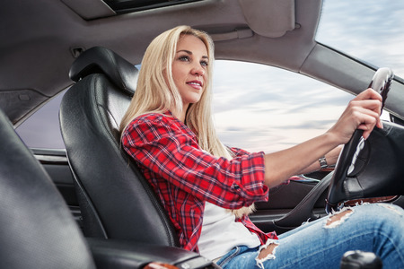 car on the road: Young blonde drive a car Stock Photo