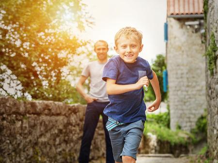 kids outside: Running little boy portrait