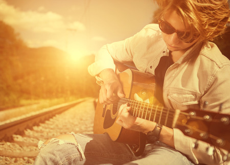 guitar: Guy with guitar on the railway