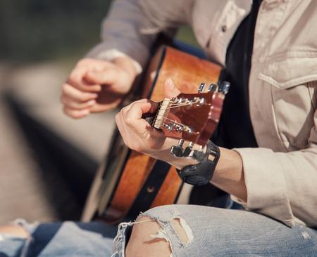 close up image: Man hands with guitar close up image Stock Photo
