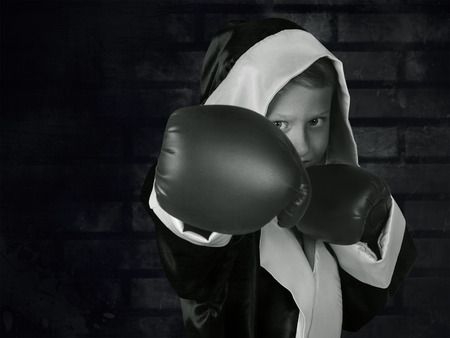 boxing boy: Boxing boy black and white portrait on dark grunge texture