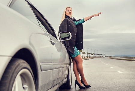 chagrin: Lady in high heel shoes with broked car on the highway