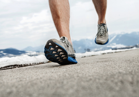 men running: Close up image runner legs in running shoes Stock Photo