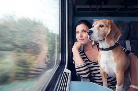 woman on train with dog
