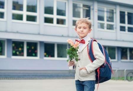 pupil: Pupil boy near the school