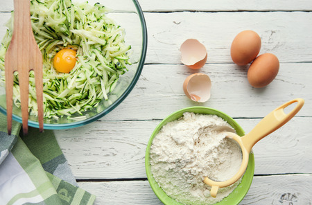 rushed: Table with ingredients for cooking zucchini pancakes