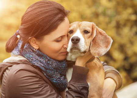 love sad: Woman and her favorite dog portrait Stock Photo