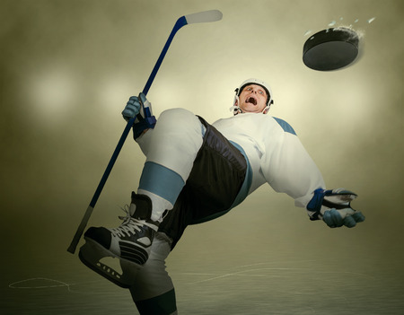 humoristic: Comic moment of the Ice Hockey game: player dodging puck