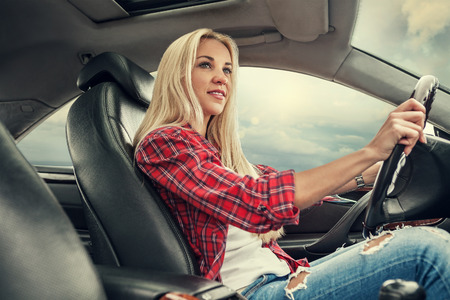 blonde woman: Young blonde drive a car Stock Photo