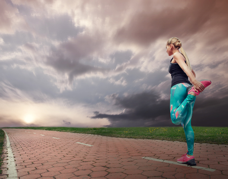 health and fitness: Blonde girl started running Stock Photo