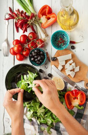 salads: Vegetarian low calorie Greek salad preparation top view Stock Photo