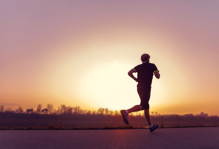 people running: Running man silhouette in sunset time