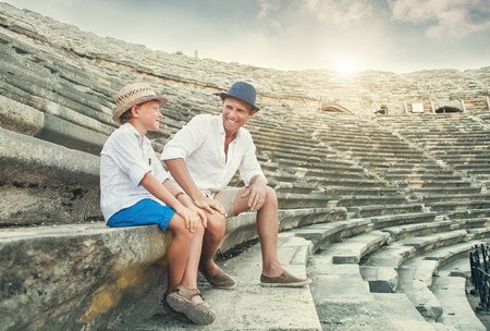 spent: Father and son spent time together on antique ruins amphitheater. Side, Turkey