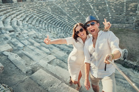 take a history: Positive young couple take self photo in Side amphitheatre