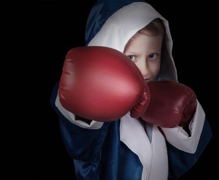 boy boxing: Boxing boy on black background
