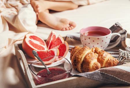light breakfast: Tray with light breakfast in bed Stock Photo
