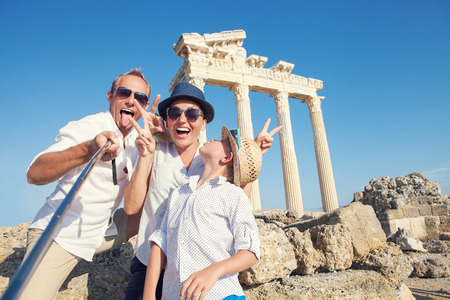 funny: Funny family take a selfie photo on Apollo Temple colonnade view in Side, Turkey