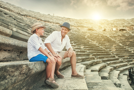 spent: Father and son spent time together on antique ruins amphitheater