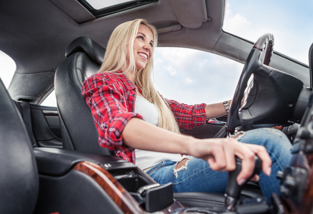 drive car: Young woman drive a car. Inside photo