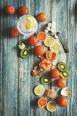 frutas tropicales: Assorted tropical fruits on blue wooden background