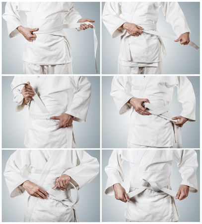 karateka: Karateka belt tying step by step pictures Stock Photo