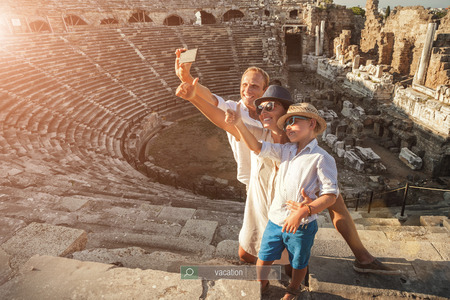 take a history: Family vacation selfie photo in anyique amphitheater in Side,Turkey Stock Photo