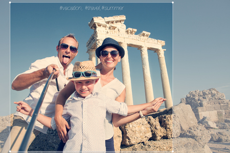 dad son: Happy family selfie travel photo cropping for share in social network. Temple of Apollo,Side,Turkey