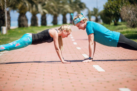 push people: Young people training push up exercise together