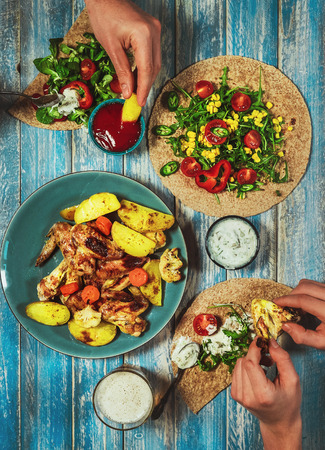 taco tortilla: Fried chicken wings with vegetable salad and taco tortilla Stock Photo