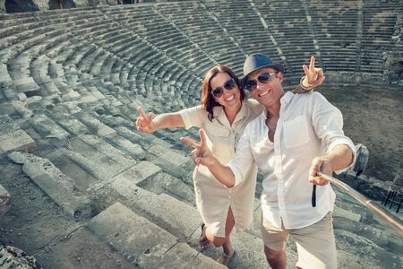 take a history: Positive young couple take a self photo