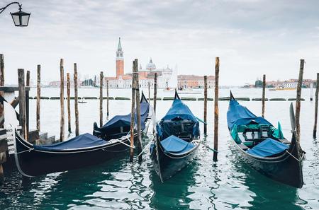venecian: Venecian gondolas parking with San Giorgio Maggiore island Stock Photo