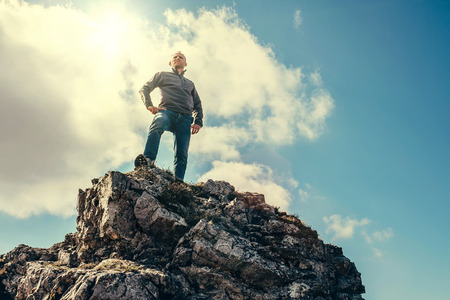 masters of rock: Man stay on the top of mountain Stock Photo