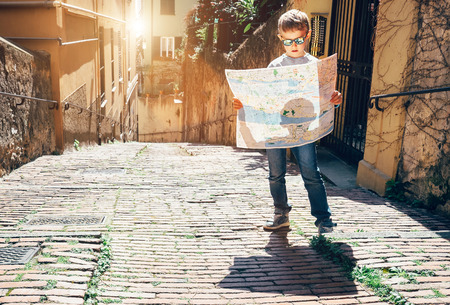 Young tourist with city map stay on the old italian street 版權商用圖片 - 56362508