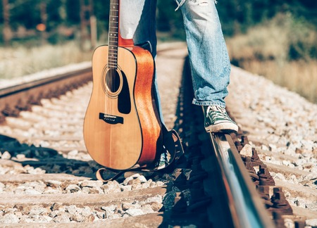 whithe: Mans legs on the railway image Stock Photo