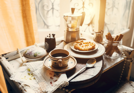 Vintage style morning coffee with biscuits Stock Photo
