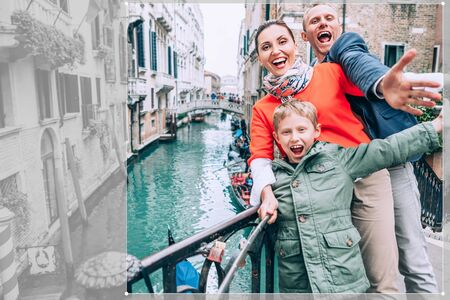 madly: Madly happy family take a selfie photo on the one of bridge in Venice Stock Photo