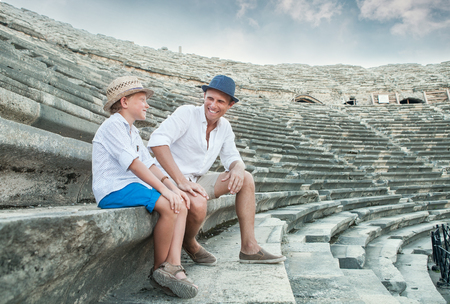 Father and son spent time together on antique ruins amphitheater Side,Turkey Stock Photo