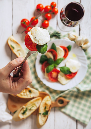 caprese: Italian traditional salad caprese and bruschetta antipasta