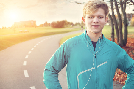 young man portrait: Young man runner portrait before starting Stock Photo