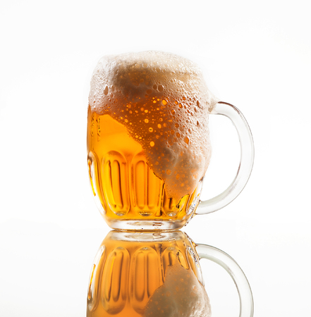 Beer in big mug on clear white background Stock Photo